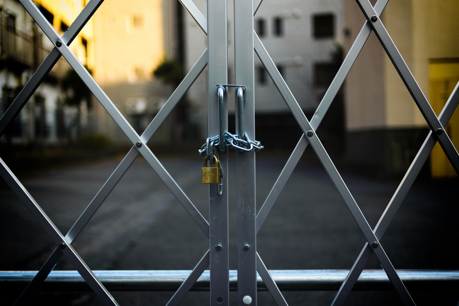 gray steel gate closed with padlock